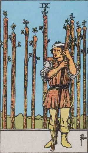 wounded man holding stave in front of eight more vertical wands nine of wands Waite Smith tarot