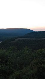 Cacapon Mountain in West Virginia twilight mounains farm river and town